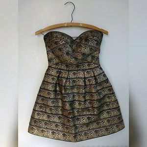 Dresses & Skirts - Black and Gold Bandage Dress